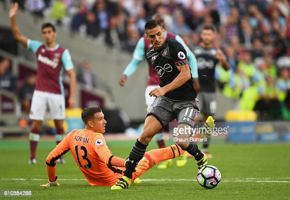 Dusan Tadic of Southampton beats Adrian of West Ham United as he scores their second goal during the Premier League match between West Ham United and...