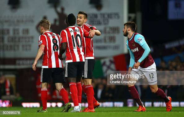 Dusan Tadic of Southampton celebrates scoring his side's first goal during the Barclays Premier League match between West Ham United and Southampton...