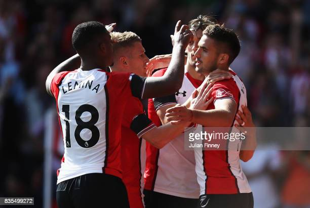 Dusan Tadic of Southampton celebrates scoring his sides second goal with his Southampton team mates during the Premier League match between...