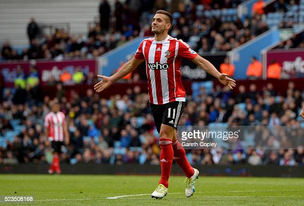 Dusan Tadic of Southampton celebrates scoring his sides third goal during the Barclays Premier League match between Aston Villa and Southampton at...