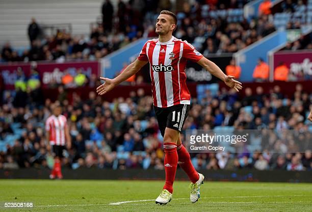 Dusan Tadic of Southampton celebrates scoring his sides third goal during the Barclays Premier League match between Aston Villa and Southampton at...