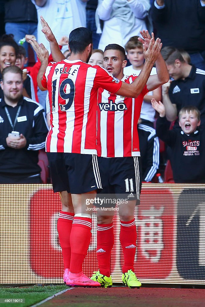 Dusan Tadic (R) of Southampton celebrates scoring his team's second goal with his team mate Graziano Pelle (L) during the Barclays Premier League match between Southampton and Swansea City at St Mary's Stadium on September 26, 2015 in Southampton, United Kingdom.