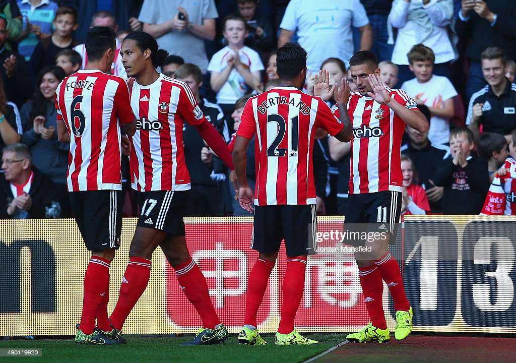 Dusan Tadic (R) of Southampton celebrates scoring his team's second goal with his team mates during the Barclays Premier League match between Southampton and Swansea City at St Mary's Stadium on September 26, 2015 in Southampton, United Kingdom.