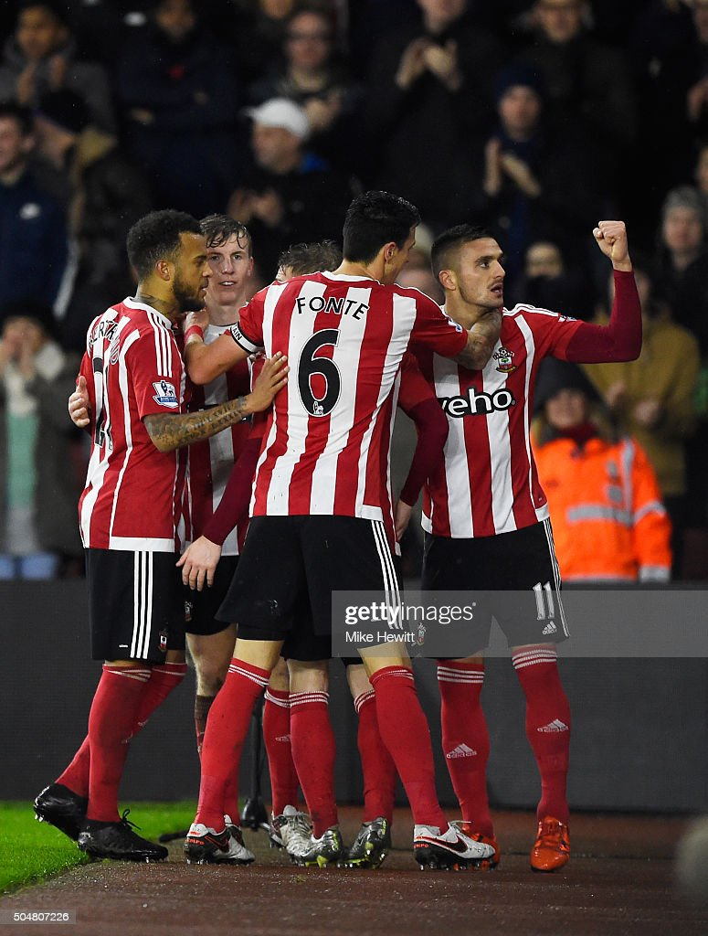 Dusan Tadic (1st R) of Southampton celebrates scoring his team's second goal with his team mates during the Barclays Premier League match between Southampton and Watford at St. Mary's Stadium on January 13, 2016 in Southampton, England.