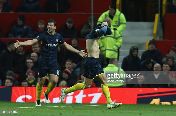 Dusan Tadic of Southampton celebrates scoring their first goal during the Barclays Premier League match between Manchester United and Southampton at...