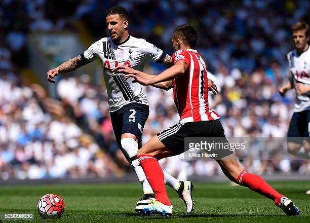 Dusan Tadic of Southampton chases down Kyle Walker of Tottenham Hotspur during the Barclays Premier League match between Tottenham Hotspur and...