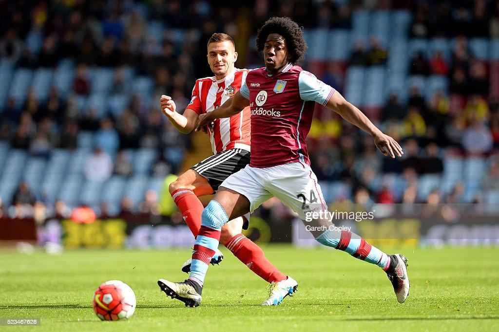 Dusan Tadic of Southampton closes down Carlos Sanchez of Aston Villa during the Barclays Premier League match between Aston Villa and Southampton at...