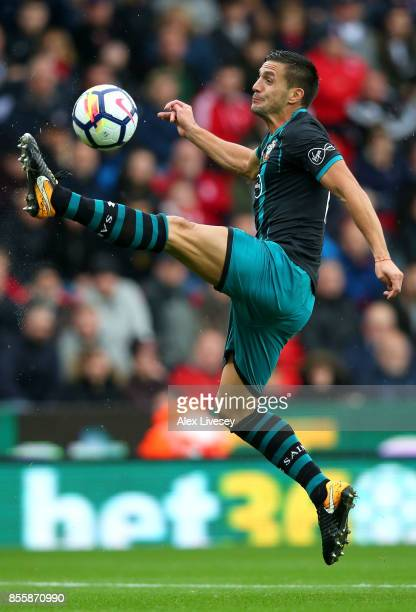 Dusan Tadic of Southampton controls the ball in mid air during the Premier League match between Stoke City and Southampton at Bet365 Stadium on...