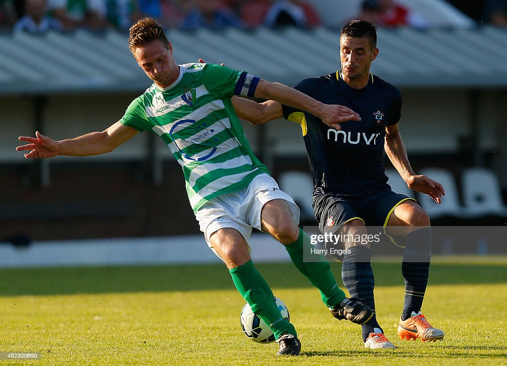 Dusan Tadic of Southampton (R) in action during the pre-season friendly match between KSK Hasselt and Southampton at the Stedelijk Sportstadion on July 17, 2014 in Hasselt, Belgium.