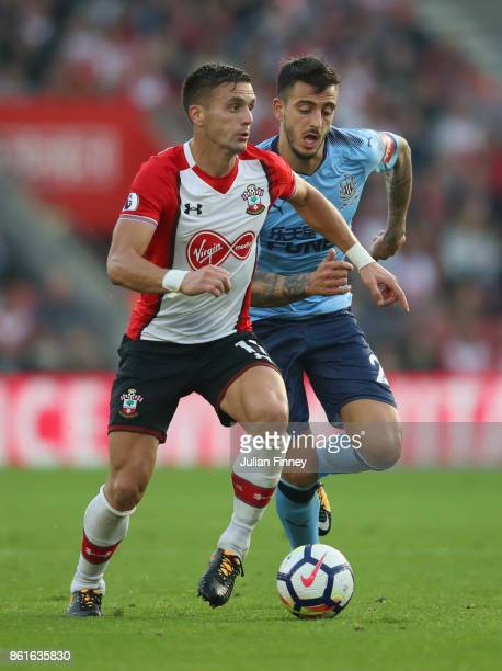 Dusan Tadic of Southampton is chased by Joselu of Newcastle United during the Premier League match between Southampton and Newcastle United at St...