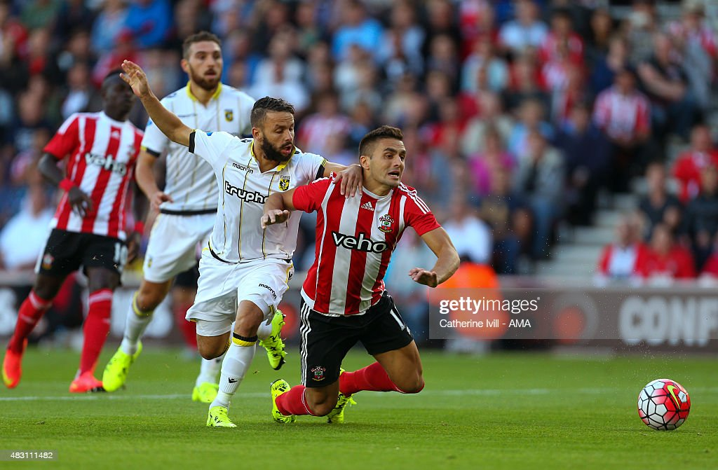 Dusan Tadic of Southampton is held back by Rochdi Achenteh of Vitesse but no penalty is given during the UEFA Europa League Qualifier between Southampton and Vitesse at St Mary's Stadium on July 30, 2015 in Southampton, England.