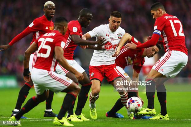 Dusan Tadic of Southampton is surrounded by the Manchester United defence during the EFL Cup Final match between Manchester United and Southampton at...