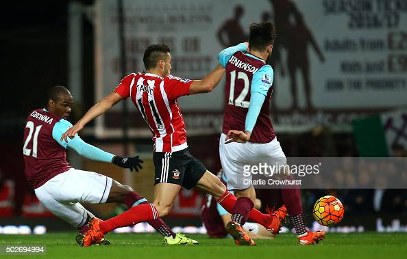 Dusan Tadic of Southampton scores his side's first goal during the Barclays Premier League match between West Ham United and Southampton at the...