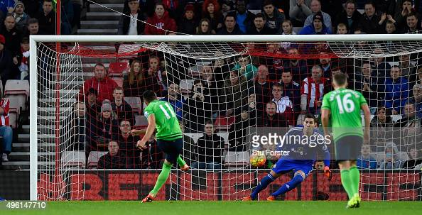 Dusan Tadic of Southampton scores the winning goal from the penalty spot past Costel Pantilimon during the Barclays Premier League match between...
