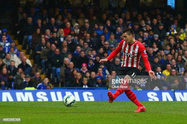 Dusan Tadic of Southampton scores their first goal from the penalty spot during the Barclays Premier League match between Chelsea and Southampton at...