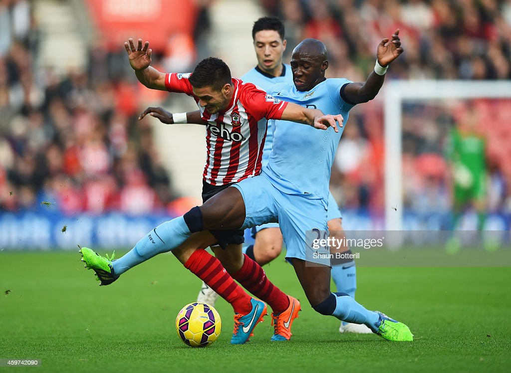 Dusan Tadic of Southampton takes on <a gi-track='captionPersonalityLinkClicked' href=/galleries/search?phrase=Samir+Nasri&family=editorial&specificpeople=648450 ng-click='$event.stopPropagation()'>Samir Nasri</a> and <a gi-track='captionPersonalityLinkClicked' href=/galleries/search?phrase=Eliaquim+Mangala&family=editorial&specificpeople=5713850 ng-click='$event.stopPropagation()'>Eliaquim Mangala</a> of Manchester City during the Barclays Premier League match between Southampton and Manchester City at St Mary's Stadium on November 30, 2014 in Southampton, England.