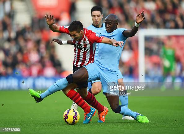Dusan Tadic of Southampton takes on Samir Nasri and Eliaquim Mangala of Manchester City during the Barclays Premier League match between Southampton...