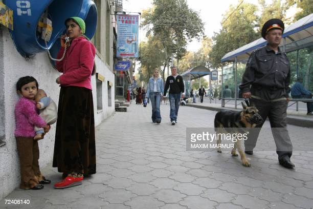 A Tajik police officer patrols a street in Dushanbe 04 November 2006 Tajik President Emomali Rakhmonov looks sure to prolong his 14year rule over...