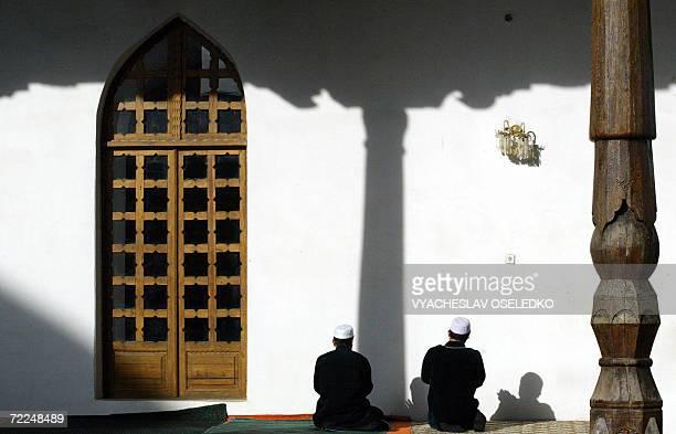 Two Tajik muslims pray in the Mavlonoa mosque outside Dushanbe 24 October 2006 Tajik leader Imomali Rakhmonov who is expected to win next month's...