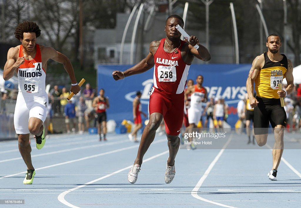 Dushane Farrier, of the Alabama Crimson Tide, anchors the Men's 4x100-meter Relay against D.J. Zahn, of the Illinois Illini, and Josh Larney, of the Iowa Hawkeyes, at the Drake Relays, on April 27, 2013 at Drake Stadium, in Des Moines, Iowa.