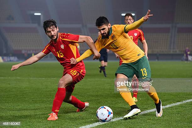 Dushko Trajchevski of Macedonia challenges Aziz Behich of Australia during the International Friendly match between Macedonia and Australia on March...
