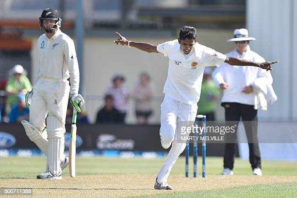 Dushmantha Chameera of Sri Lanka celebrates the wicket of New Zealand's Mitchell Santner during day one of the first International Test cricket match...