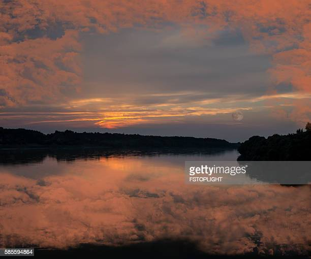 Dusk at  river with amazing clouds on sky