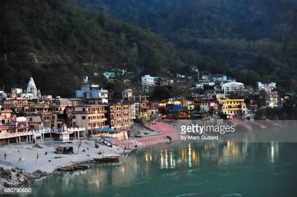 Dusk falls over the Ashram Yoga Temples along the Ganges River, Rishikesh, Uttarakhand, India