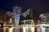 Dusk in the Cathedral Square showing Christchurch Cathedral and The Chalice, a large piece of modern sculpture in the form of an inverted cone, Christchurch, Otautahi, New Zealand, NZ