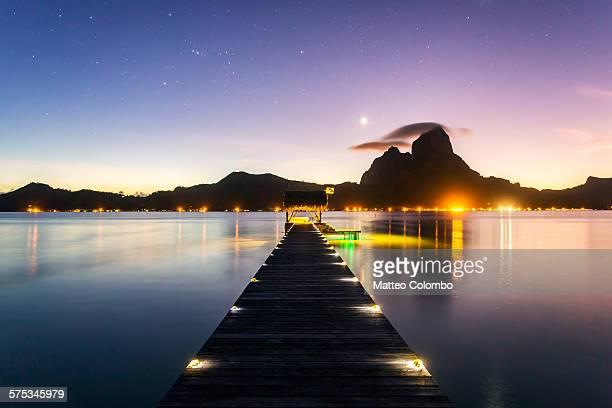 Dusk over jetty in Bora Bora lagoon, Polynesia