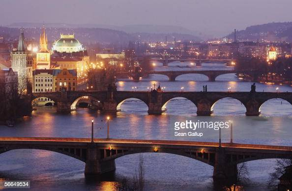 Dusk settles on bridges that cross the Moldau River January 22 2006 in central Prague Czech Republic Austrian composer Wolfgang Amadeus Mozart stayed...