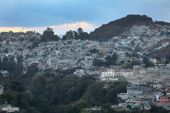 Dusk settles over the capital city's Zone 18 infamous in Guatemala for gangrelated crime on February 10 2017 in Guatemala City Guatemala The...