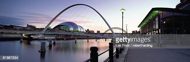 Dusk view towards Millennium Bridge, Tyne Bridge and Sage Music Hall, Quayside, River Tyne, Newcastle upon Tyne, Tyne and Wear, England, United Kingdom, Europe
