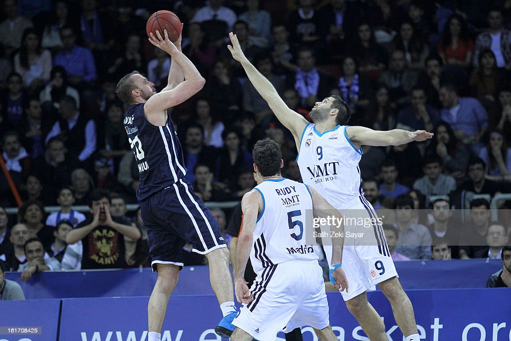 Dusko Savanovic #20 of Anadolu Efes competes with <a gi-track='captionPersonalityLinkClicked' href=/galleries/search?phrase=Felipe+Reyes&family=editorial&specificpeople=732755 ng-click='$event.stopPropagation()'>Felipe Reyes</a> #9 and Rudy Fernandez #5 of Real Madrid during the 2012-2013 Turkish Airlines Euroleague Top 16 Date 7 between Anadolu EFES Istanbul v Real Madrid at Abdi Ipekci Sports Arena on February 14, 2013 in Istanbul, Turkey.