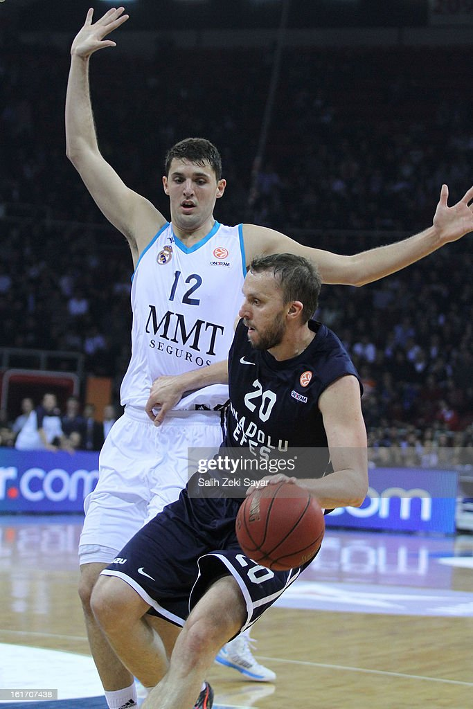 Dusko Savanovic #20 of Anadolu Efes competes with Nikola Mirotic #12 of Real Madrid during the 2012-2013 Turkish Airlines Euroleague Top 16 Date 7 between Anadolu EFES Istanbul v Real Madrid at Abdi Ipekci Sports Arena on February 14, 2013 in Istanbul, Turkey.
