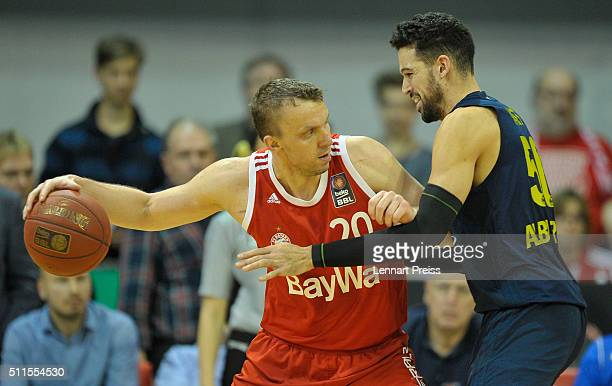 Dusko Savanovic of FC Bayern Muenchen challenges Mitchell Watt of ALBA Berlin during the Beko BBL TOP FOUR Final match between FC Bayern Muenchen and...