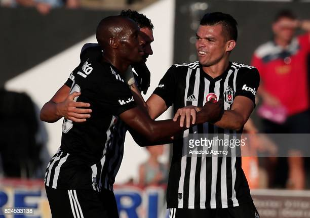 Dusko Tosic Pepe and Atiba Hutchinson of Besiktas celebrate after scoring a goal during a friendly match between Besiktas and Real Betis as part of...