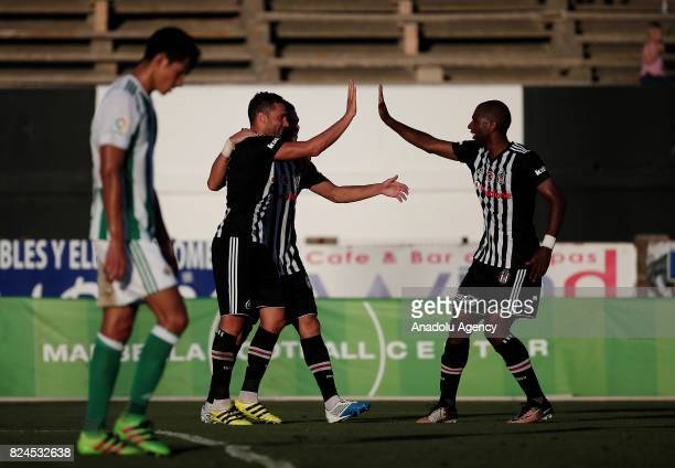 Dusko Tosic Ryan Babel and Pepe of Besiktas celebrate after scoring a goal during a friendly match between Besiktas and Real Betis as part of the new...