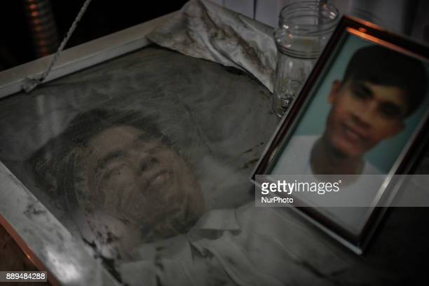 Dust covers the coffin of Junior Amadeo who was killed by unidentified assailants at his funeral wake in Navotas Metro Manila Philippines August 8...