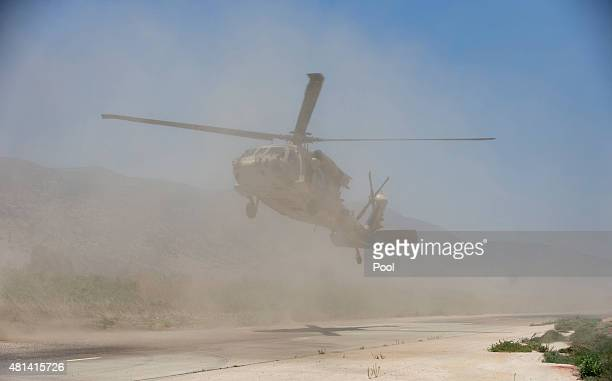 Dust flies as US Defense Secretary Ash Carter and Israeli Defense Minister Moshe Ya'alon arrive in a UH60 Blackhawk helicopter at the Hula Valley...