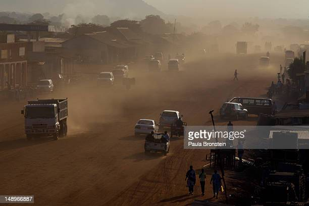Dust is seen in the air as traffic moves along a major road under construction as the government continues to make improvements on the city's streets...