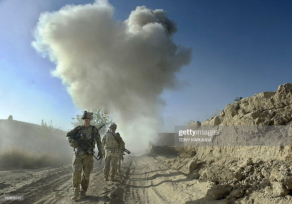 Dust kicks off the ground during an operation by US Army soldiers attached to the 2nd platoon, C-Coy. 1-23 Infantry based at Zangabad foward operating base in Panjwai ditrict after Anti Personnel Obstacle Breaching System -- abbreviated as A-POBS (charges fired by rocket and trigger safe detonation of IED's used to make roadside bombs) -- detonate on a nearby road during a dawn operation at Naja-bien village on September 23, 2012. A total of 374 civilians were killed and 581 injured in August as a result of the war in Afghanistan, making it the second deadliest month for civilians since 2007, the United Nations said. AFP PHOTO/Tony KARUMBA