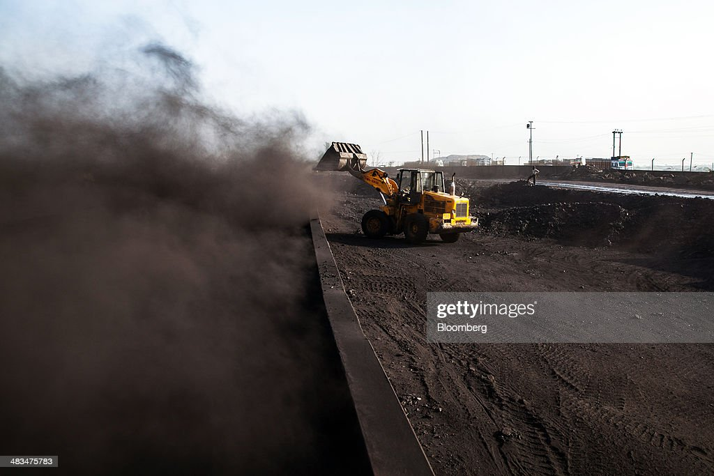 Dust rises as a loader fills a railcar wagon with coal at a depot, operated by Coal India Ltd. subsidiary Bharat Coking Coal Ltd. (BCCL), in Jharia, Jharkhand, India, on Sunday, April 6, 2014. Coal India, the worlds largest producer, estimates on its website that the nation faces a supply deficit of 350 million tons by 2016-2017, thereby overtaking import demand from China, the worlds biggest coal consumer and producer. Photographer: Sanjit Das/Bloomberg via Getty Images