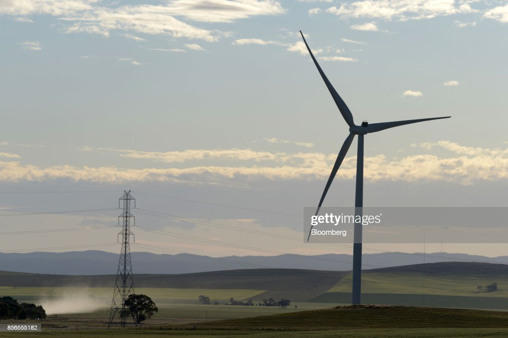 Dust rises as a wind turbine stands silhouetted at the Hornsdale wind farm, operated by Neoen SAS, near Jamestown, South Australia, on Friday, Sept. 29, 2017. About half the capacity of the worlds largest lithium-ion battery project is installed at Hornsdale wind farm in South Australia, Tesla chief executive officer Elon Musksaid at an event on Sept. 29. When this is done in just a few months, it will be the largest battery installation by a factor of three in the world, Musk said. Photographer: Carla Gottgens/Bloomberg via Getty Images