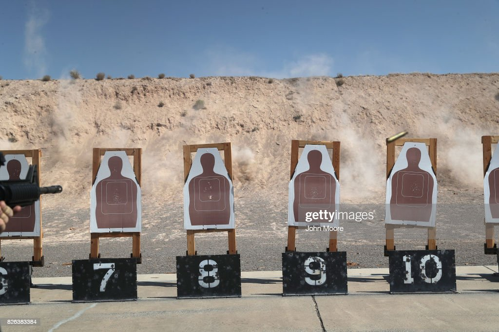 Dust rises as U.S. Border Patrol trainees fire M-4 rifles at targets during a weapons training class at the U.S. Border Patrol Academy on August 3, 2017 in Artesia, New Mexico. All new agents must complete a rigorous months-long training course at the New Mexico facility before assuming their posts at Border Patrol stations, mostly along the U.S.-Mexico border. President Trump has pledged to add an additional 5,000 agents to the existing Border Patrol force of more than 21,000 as part of his border security policy.