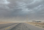 Dust storm blowing across deserted road
