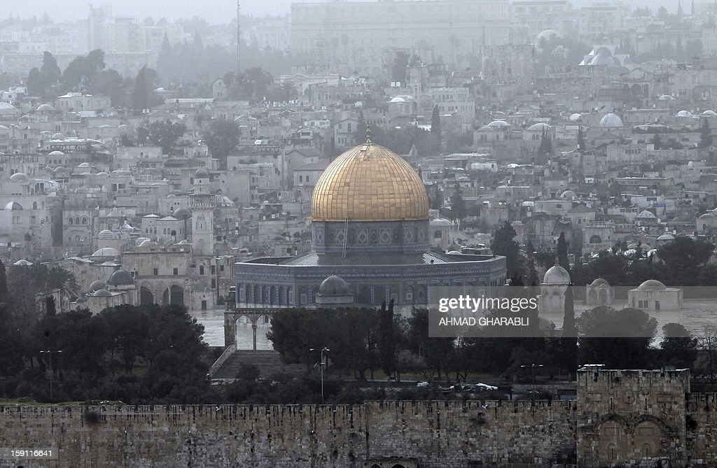 A dust storm covers Jerusalem's old city and the Dome of the Rock mosque, on January 8, 2013. Stormy weather, including high winds and heavy rainfall, lashed Israel and the Palestinian territories, downing powerlines and trees and causing several injuries. In the background is Islam's Dome of the Rock. AFP PHOTO/AHMAD GHARABLI