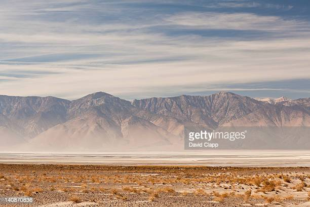 Dust storm in front of mountains in Death Valley