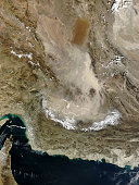 January 23, 2010 - Pale tan dust billows over the Dasht-e Lut, a large salt desert in eastern Iran. The dust storm blows across the southern desert, leaving clear the distinctive orange dune fields an
