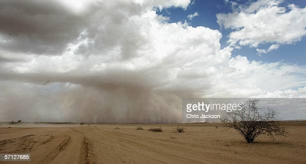 A dust storm moves across the barren plains of northern Kenya March 17 2006 in Wajir Kenya Thousands of people are facing starvation due to deepening...